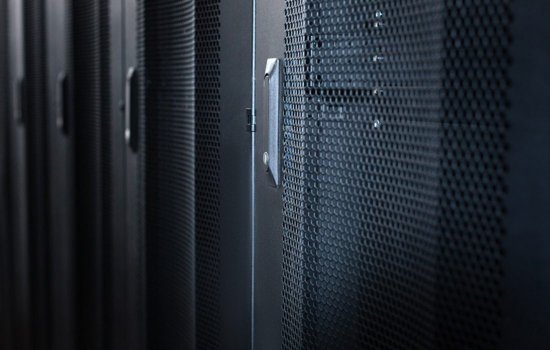 Data center. Black metal stylish modern server cabinets in a data center